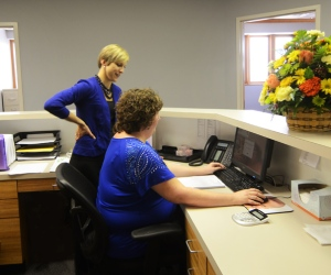 Emily working with Holly, Accounting Department, Community Home Health Care